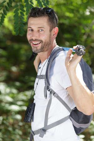happy male walks in the park 版權商用圖片