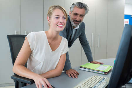 two entrepreneurs sitting together working in an office