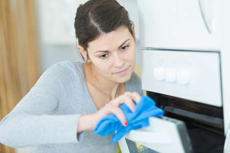 wiping the oven