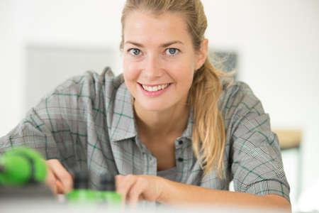 cute female engineer at home working on technology Zdjęcie Seryjne