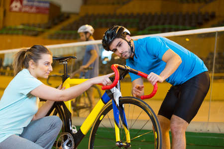 cyclist and coach in a velodrome