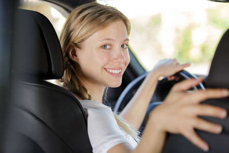 young female driving a car