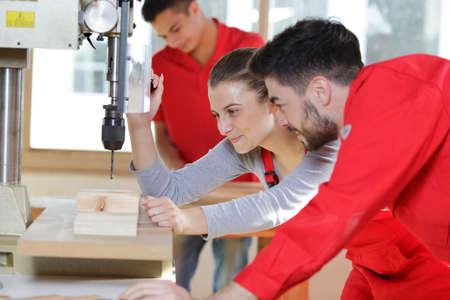 wood milling machine in action Zdjęcie Seryjne - 134960195