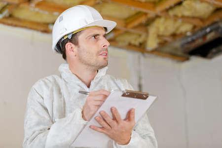 close-up worker inspector holding clipboard Zdjęcie Seryjne - 134960268