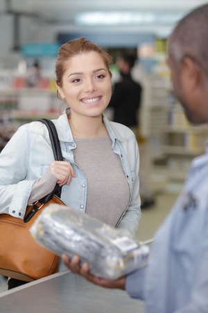 male sales assistant talking to female customer