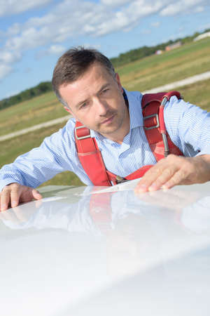 portrait of a pilot inspecting sailplane