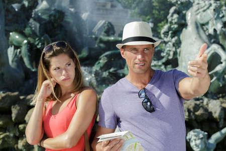 handsome man pointing at something while girlfriend is upset Zdjęcie Seryjne - 134960405