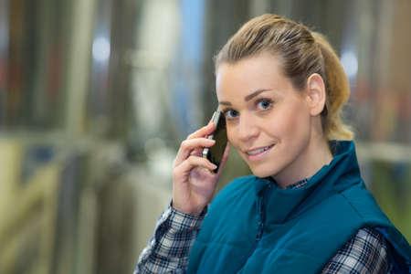 female worker speaking on mobile phone in an industrial area Zdjęcie Seryjne - 134960447