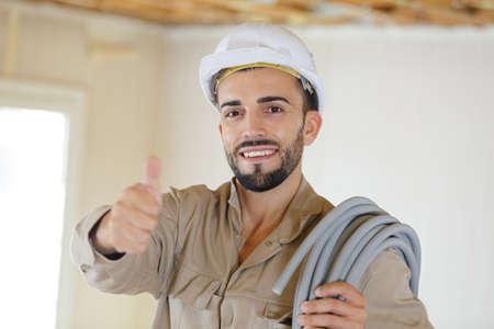 a man builder showing thumb-up Zdjęcie Seryjne - 134960448