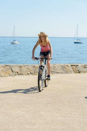woman biking on the boulevard Фото со стока