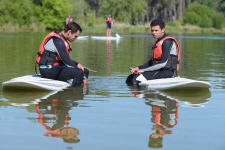 two people stand up paddle Reklamní fotografie
