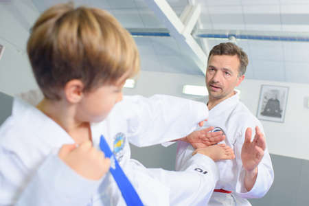 Little boy learning a martial art Imagens