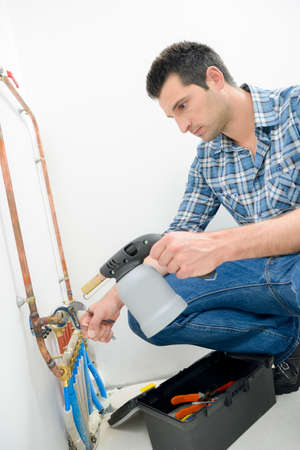 plumber is mending some pipes