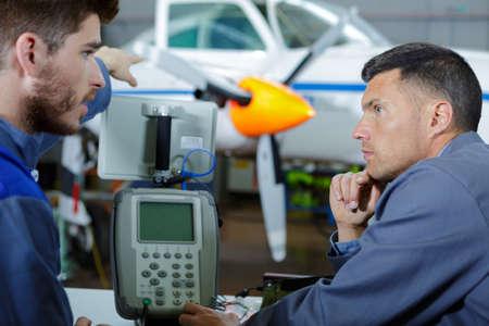 aircraft maintenance mechanic inspects plane chassis