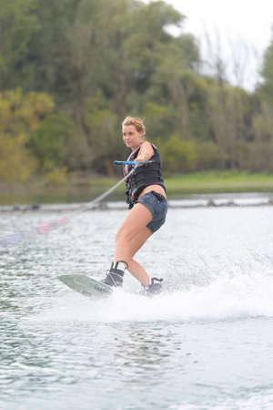 athlete enjoys wakeboarding on the river