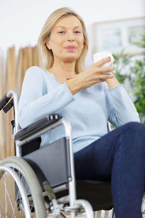 disabled senior woman having a coffee Zdjęcie Seryjne