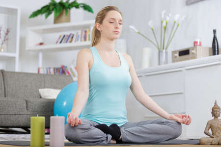 woman in yoga class with workout gear