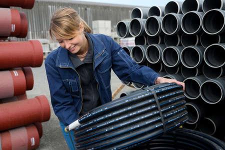 Young hardworking woman checking pipes Zdjęcie Seryjne
