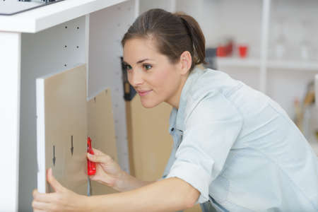 Woman moving into new apartment house assembling