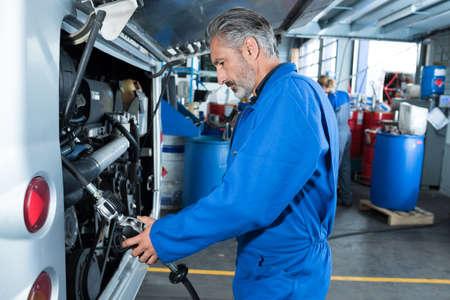 a bus mechanic at work 写真素材
