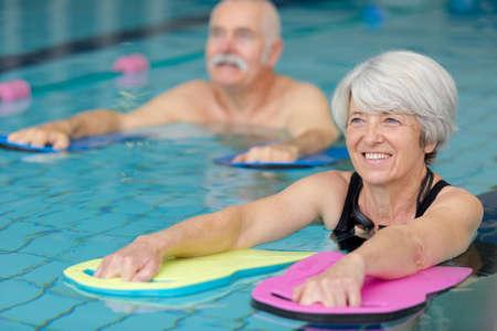 portrait of seniors doing water exercises