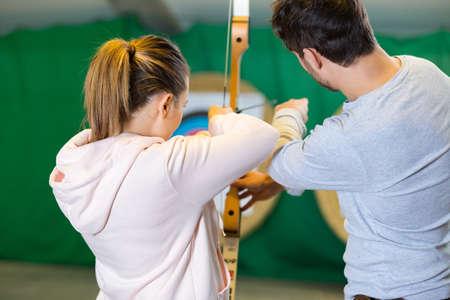 People practicing indoor archery Zdjęcie Seryjne