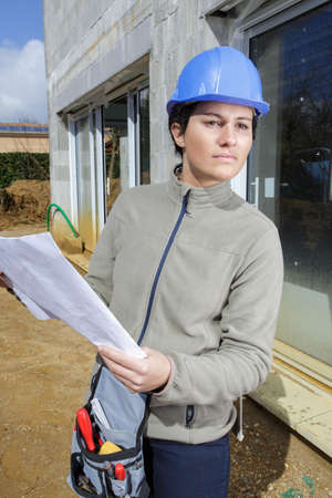 Young  woman in builder outdoors