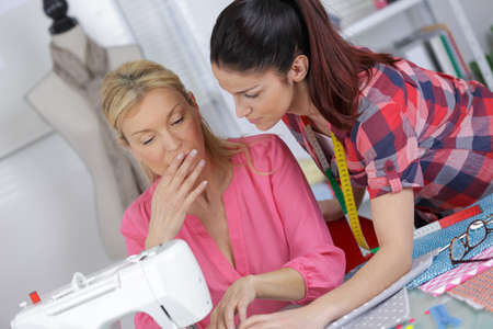 Female dressmaker working with sewing machine