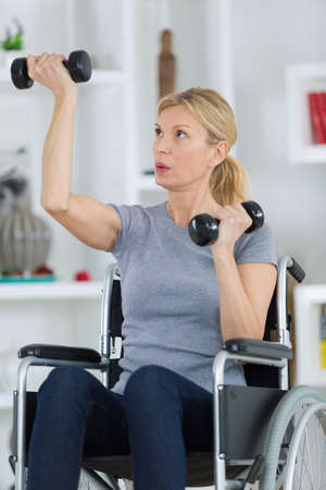 Disabled woman exercising at home Zdjęcie Seryjne