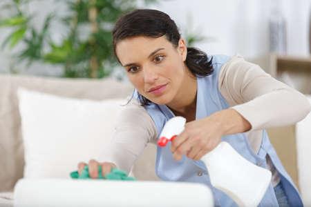 Woman spraying a detergent