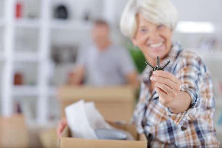 Senior woman showing the keys