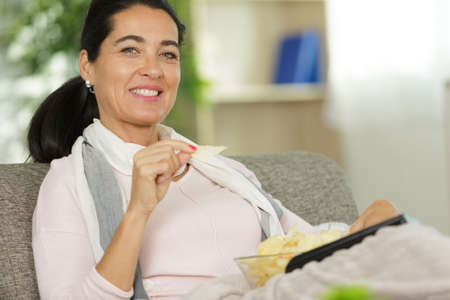 Woman holding a bowl of chips