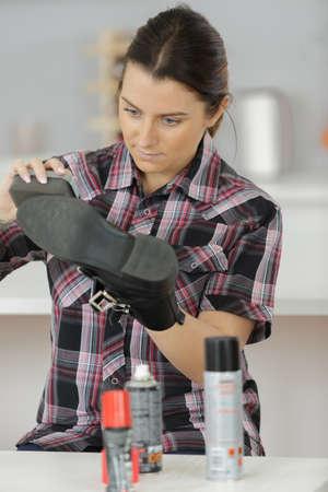 Girl applying shoe shine product on her shoe