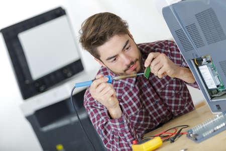 Man soldering chip