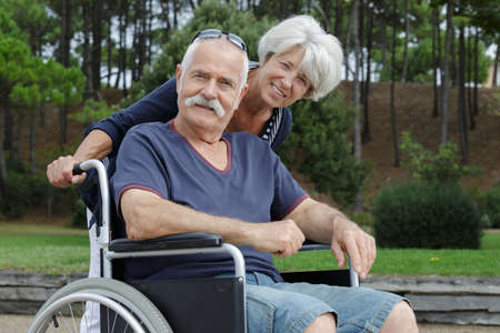 Senior man and woman from care home in park