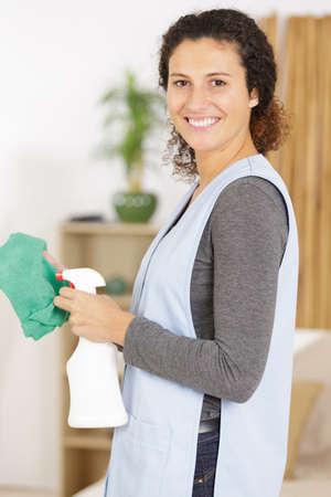 Housekeeper using a spray detergent