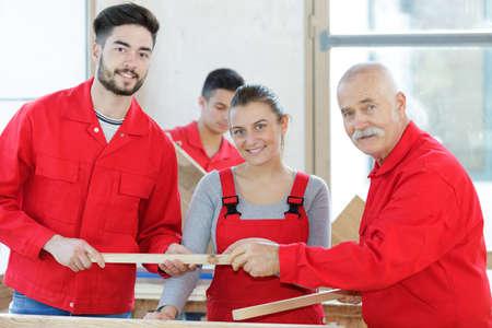 Woman and man as apprentice being tested by craftsman Zdjęcie Seryjne