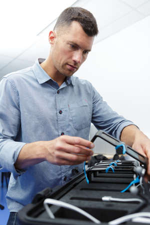 Factory chief engineer checking vr headset designs