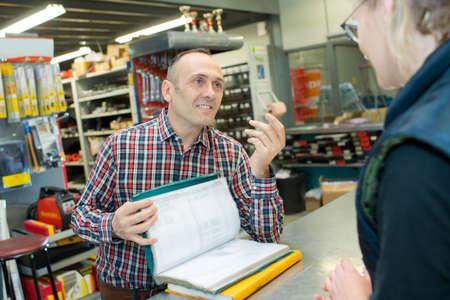 Man selling something to customer in warehouse