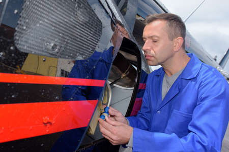 A busy aviation mechanic at work