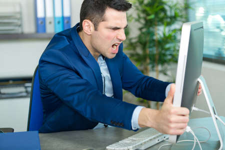 Desperate man looking at his computer