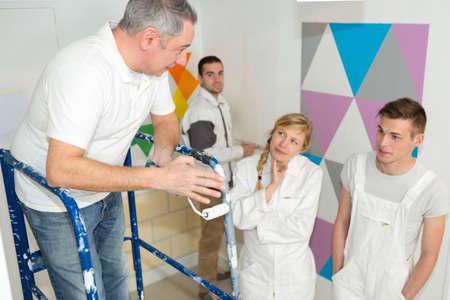 Portrait of a painter with apprentices