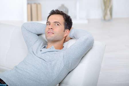Man day dreaming on the sofa Zdjęcie Seryjne