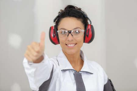 woman contractor worker cancelling headphones Reklamní fotografie