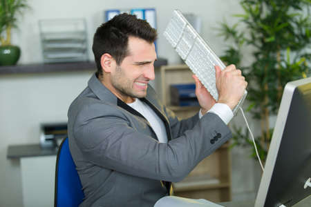 angry businessman in office