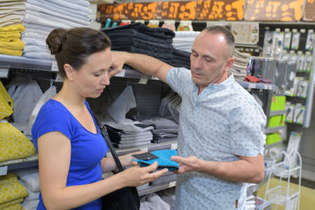 portrait of couple buying towels