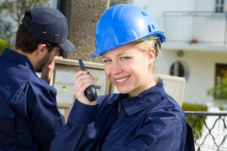 female worker talks on the walkie-talkie