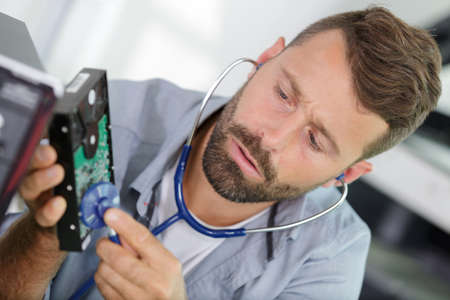 man during examination of modern device Standard-Bild - 138444761