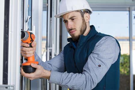 man working on a window Reklamní fotografie