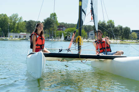 couple sailing in a lake